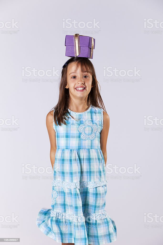 Little girl with a christmas present royalty-free stock photo