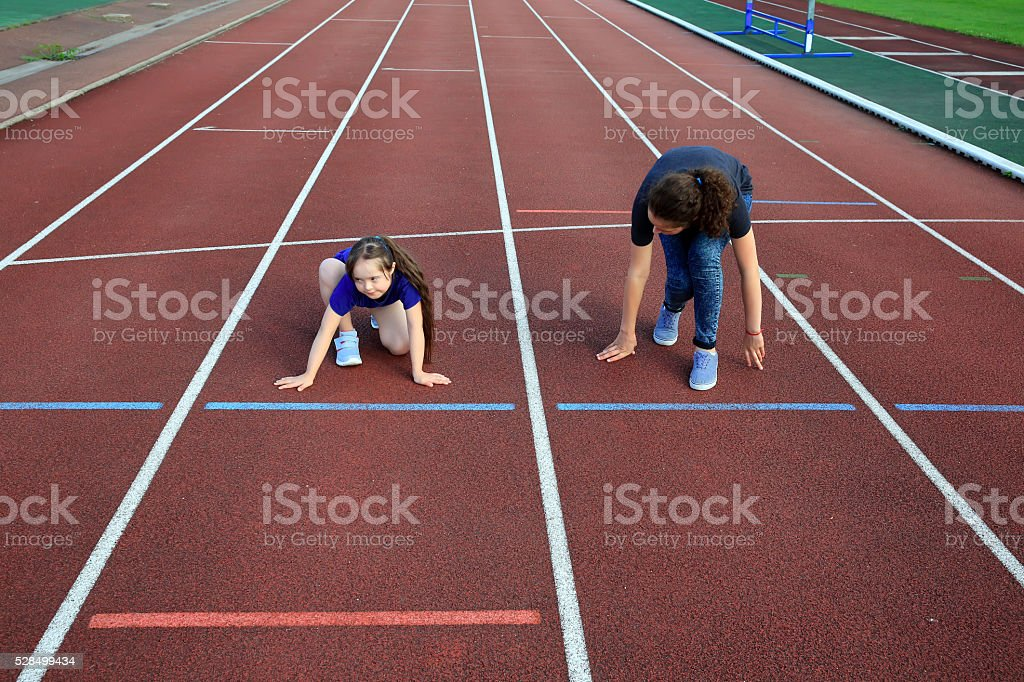Little girl  with a coach on stadium stock photo