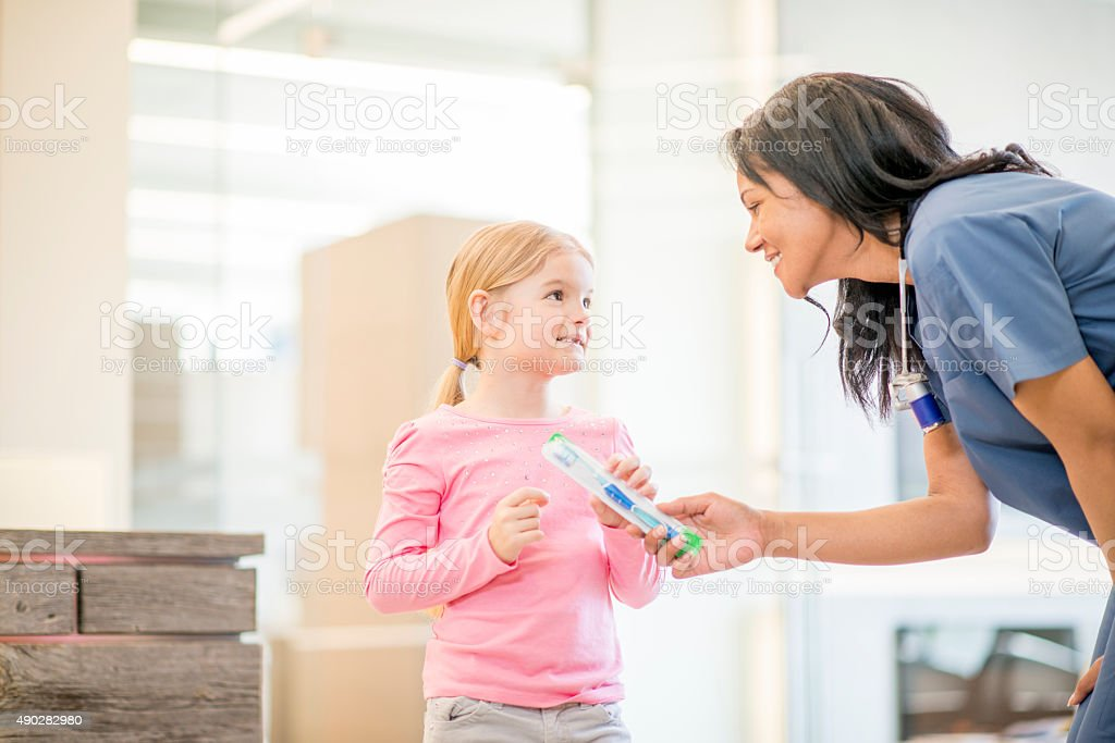 Little Girl With a Dental Assistant stock photo