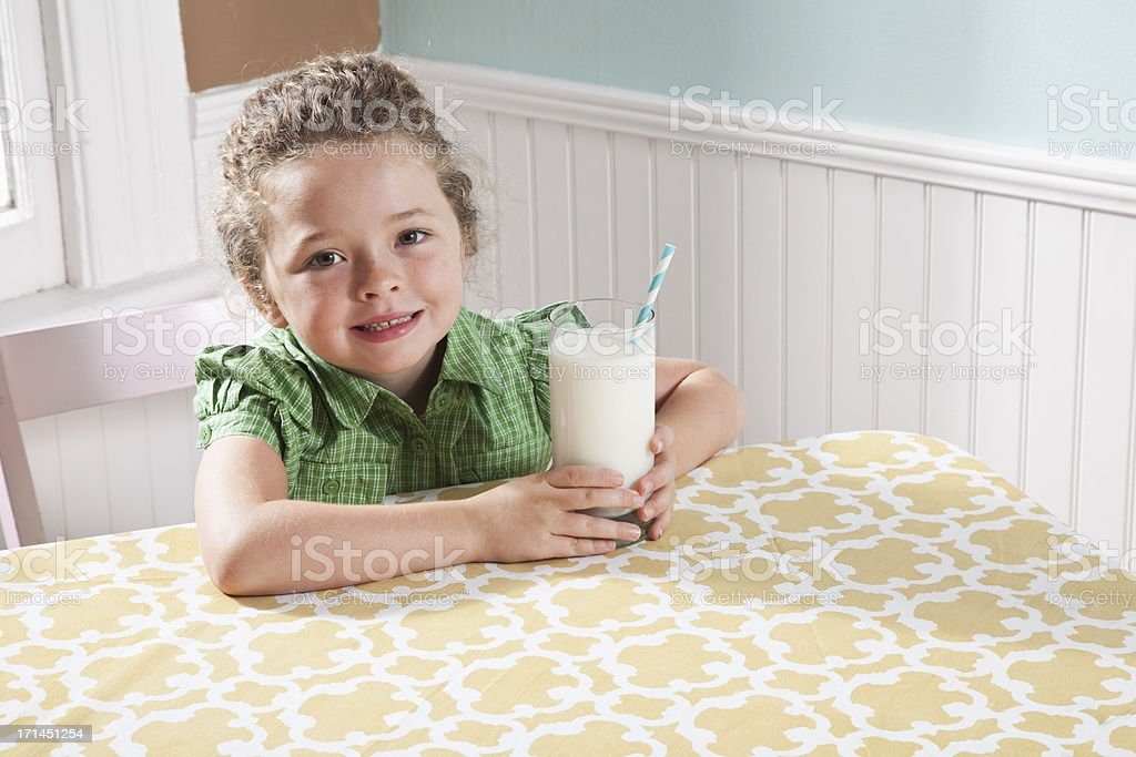 Little girl with a glass of milk stock photo