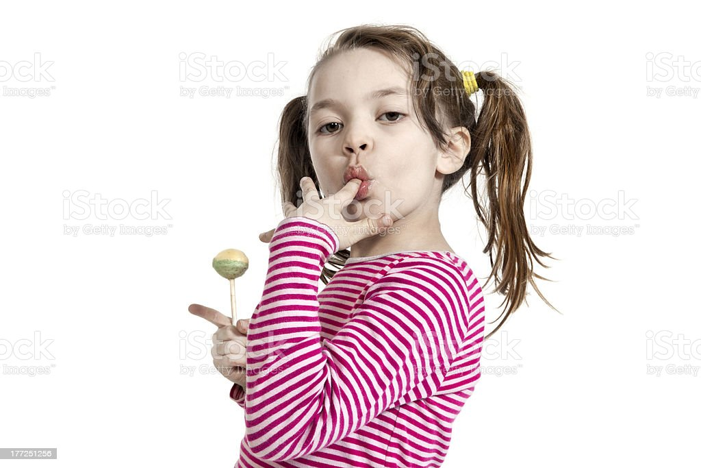 little girl with a lollipop royalty-free stock photo