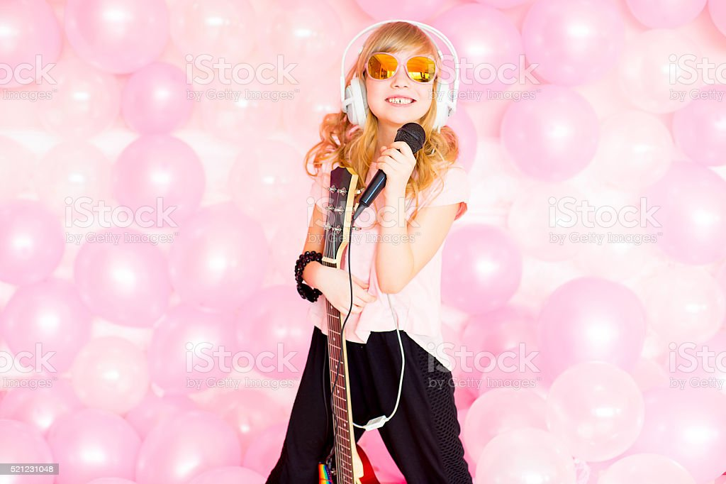little girl with a microphone stock photo