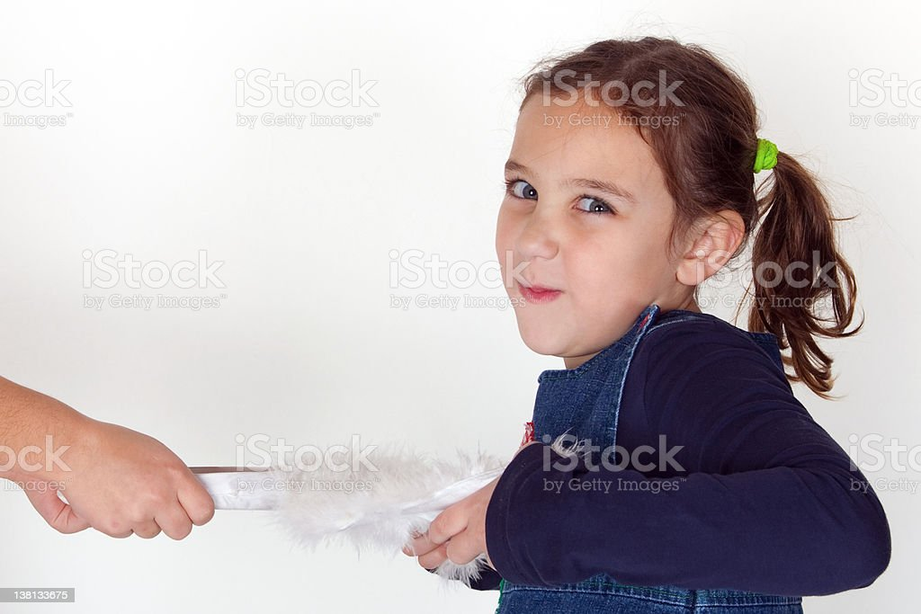 Little girl with a mischievous look on her face royalty-free stock photo