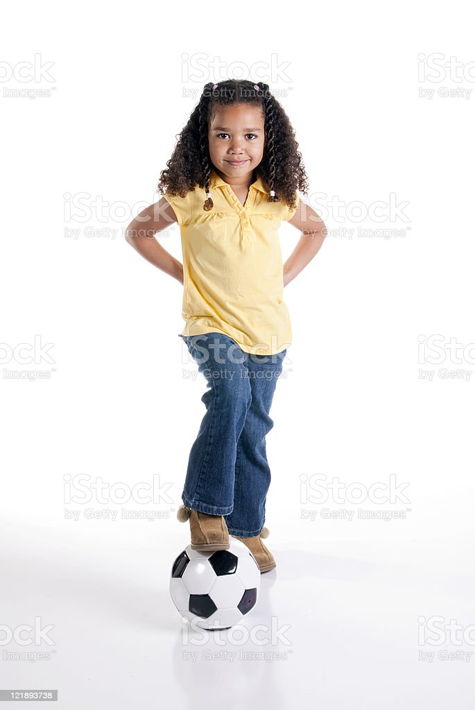 Little Girl with a Soccer Ball on White Background royalty-free stock photo