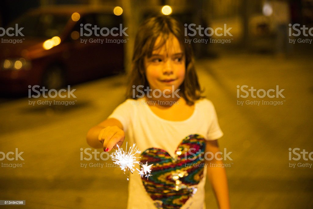 Little girl with a sparkler, Barcelona stock photo