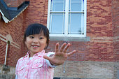 Little girl with a STOP hand sign