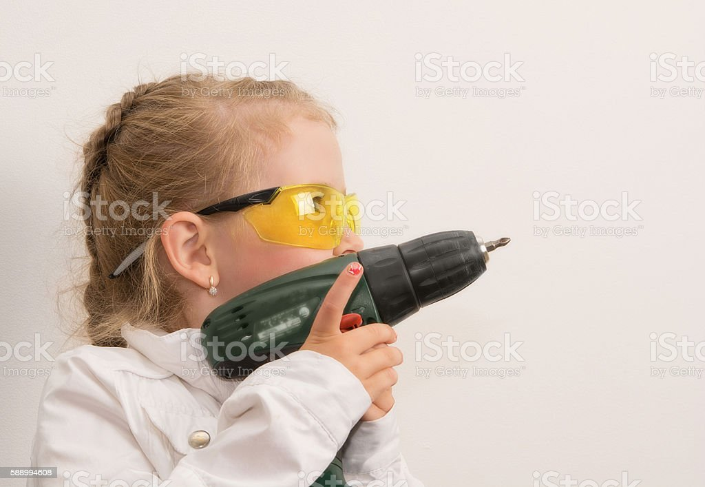 little girl with a tool stock photo