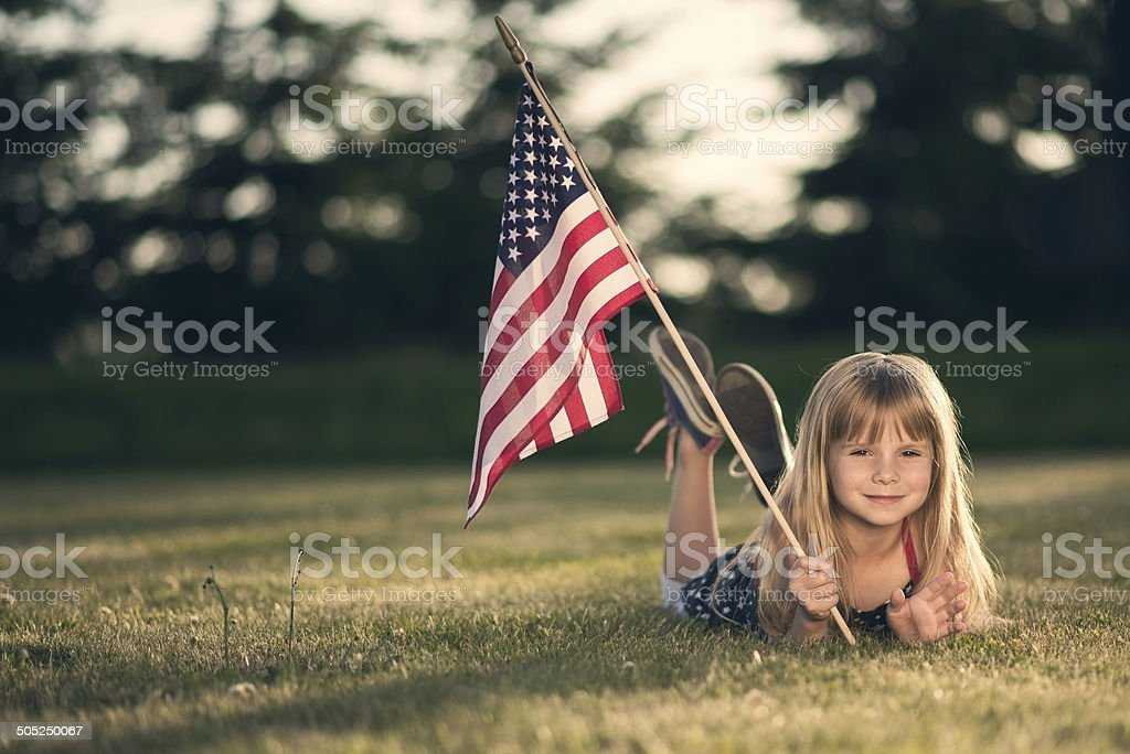 Little girl with American flag. stock photo