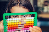Little girl with an abacus doing counting