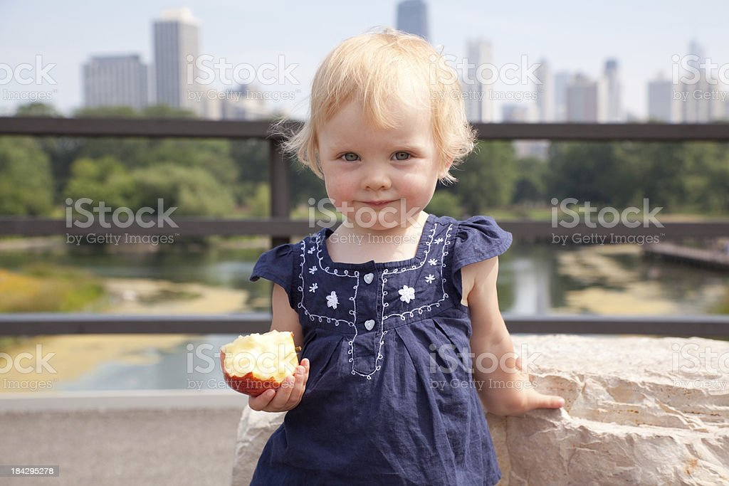 Little girl with an apple royalty-free stock photo
