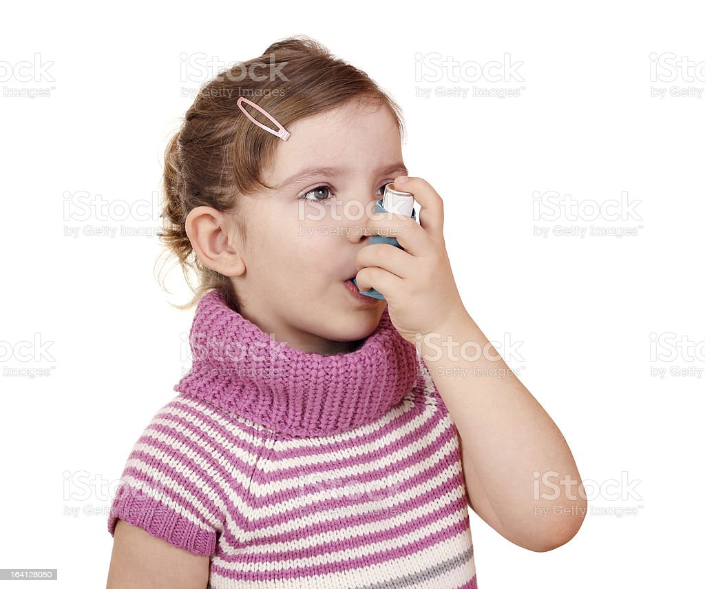 little girl with asthma inhaler royalty-free stock photo