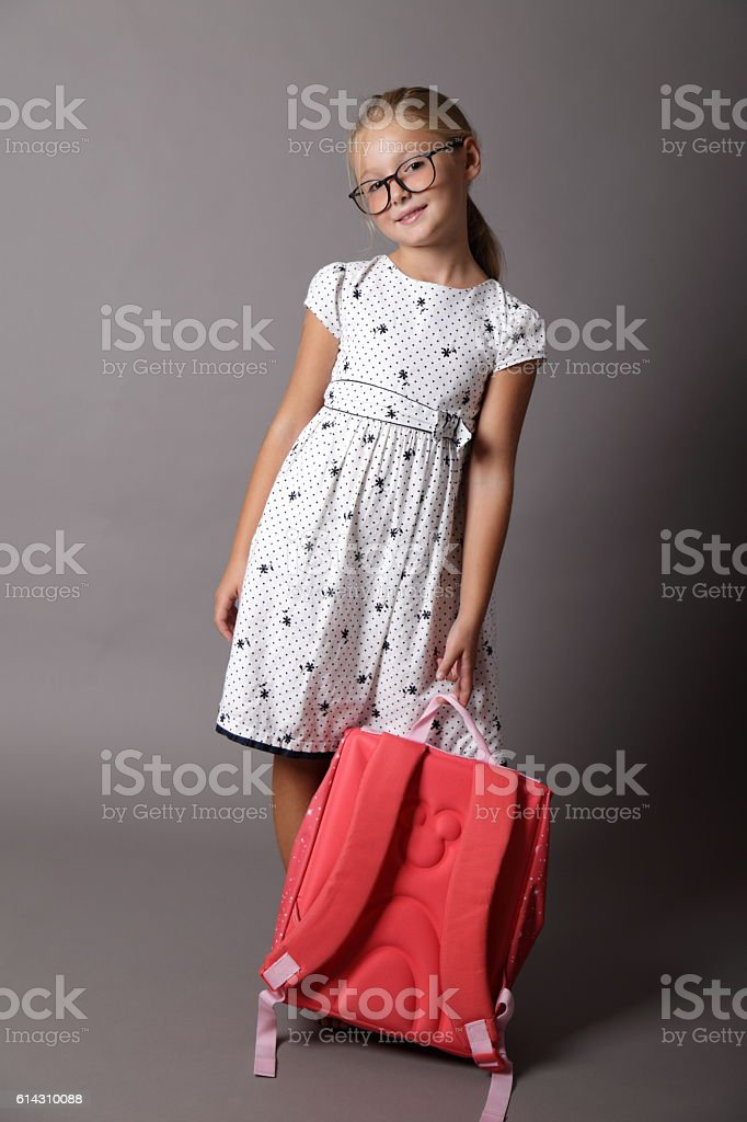 Little girl with backpack ready for school stock photo