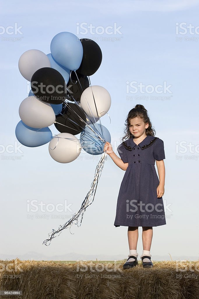 Little Girl with Balloons royalty-free stock photo