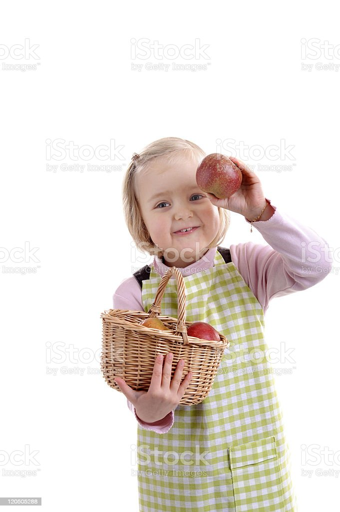 little girl with basket full of apples stock photo