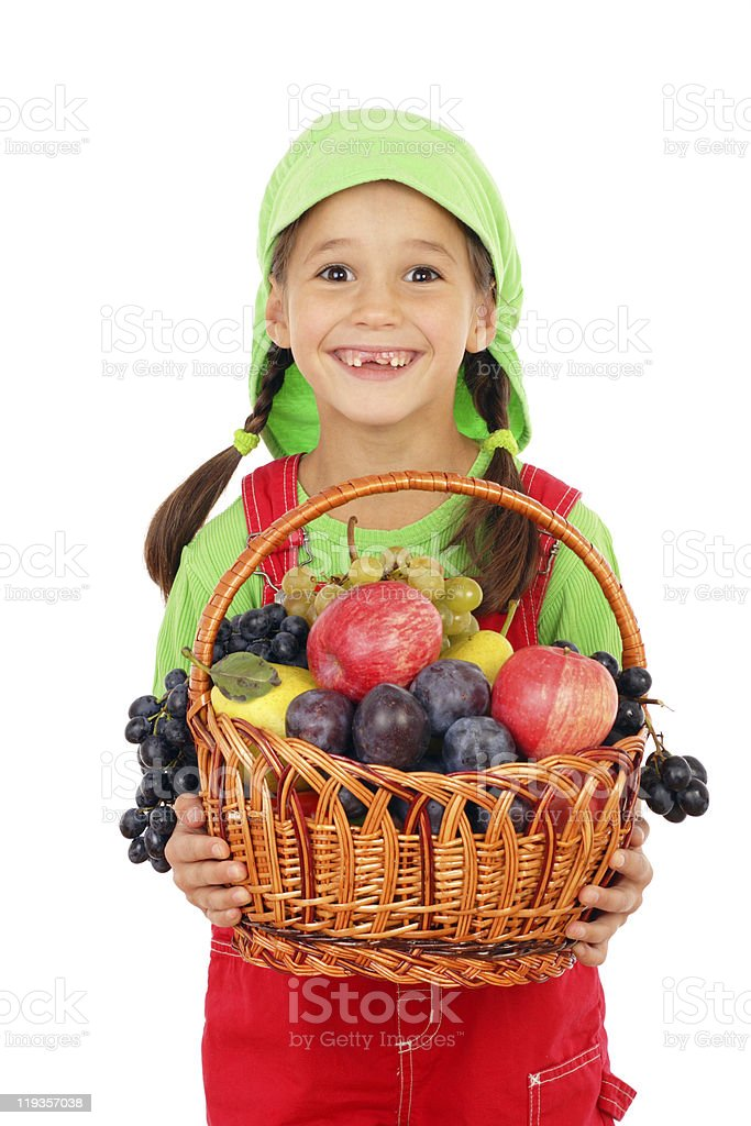 Little girl with basket of fruits royalty-free stock photo