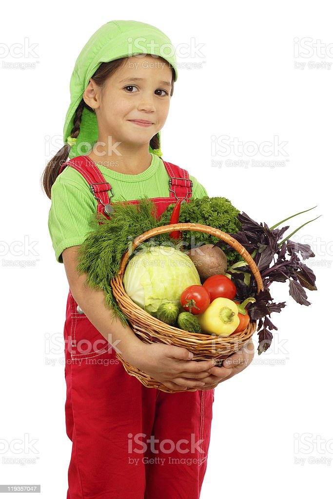 Little girl with basket of vegetables royalty-free stock photo