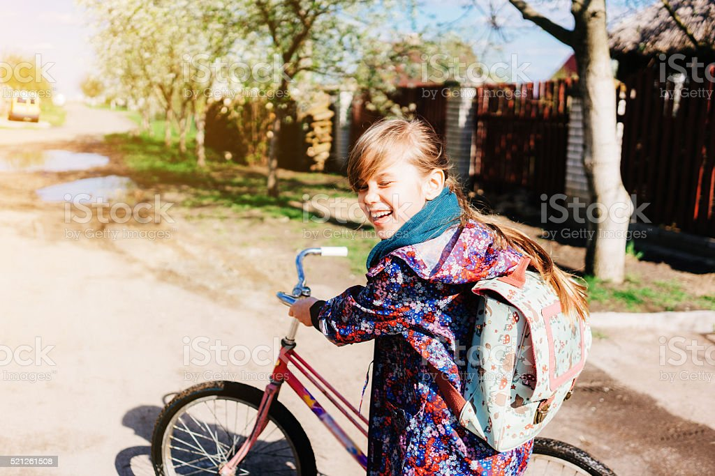 Little girl with bicycle stock photo