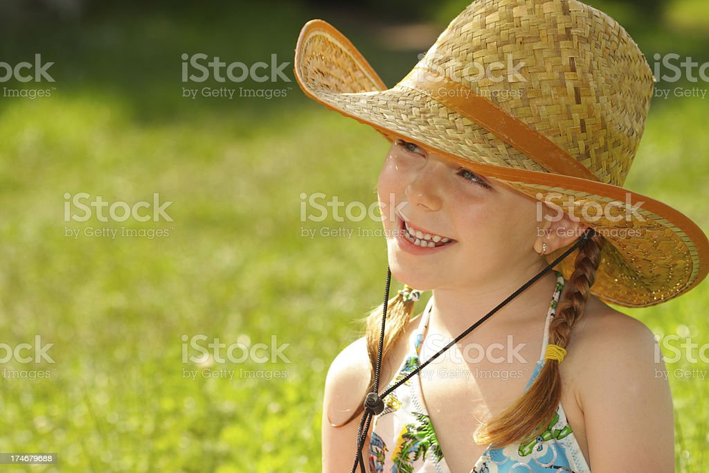 Little girl with big cowboy hat royalty-free stock photo