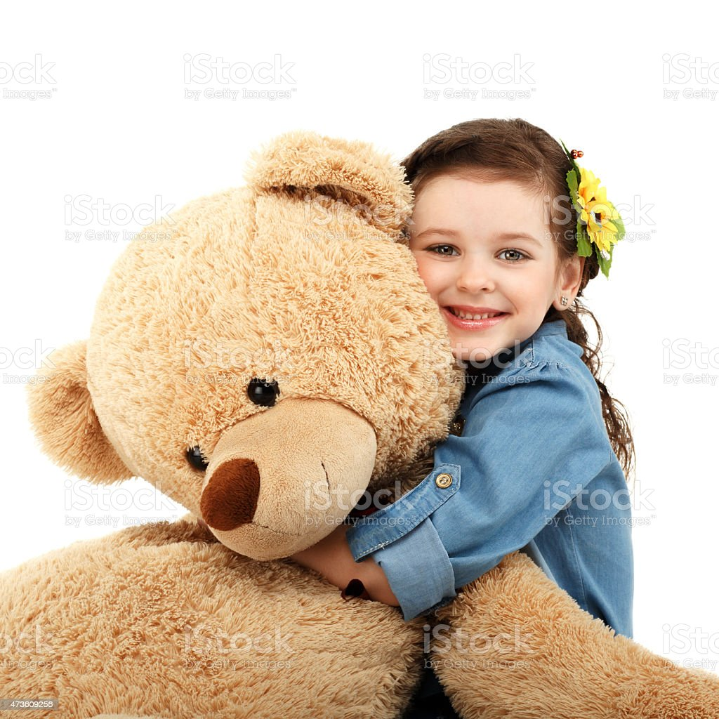 Little girl with big teddy bear having fun laughing stock photo