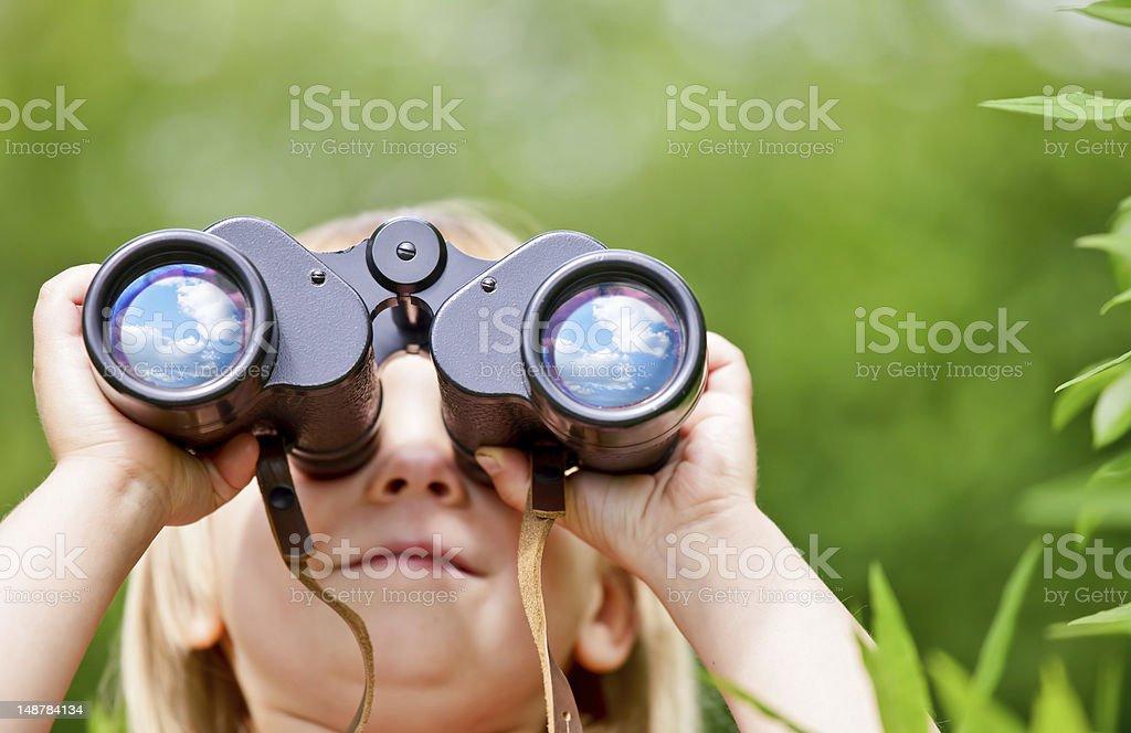 Little girl with binocular stock photo