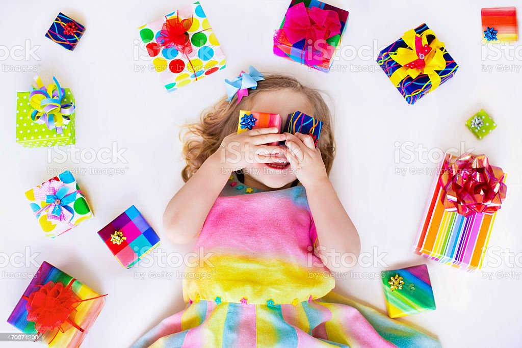 Little girl with birthday presents stock photo