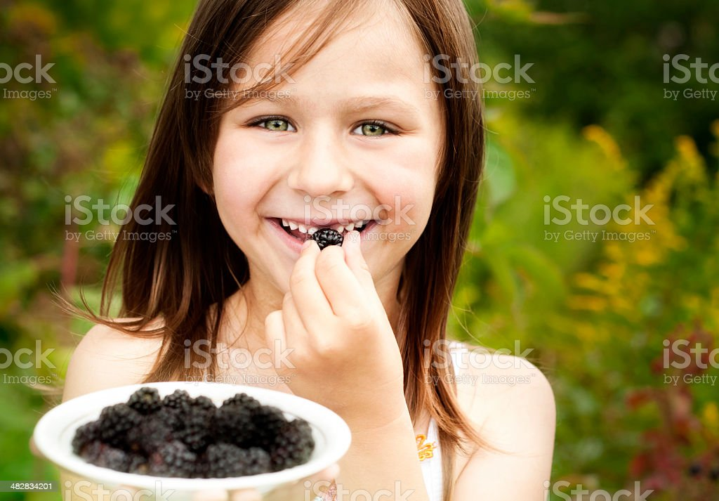 Little girl with blackberry royalty-free stock photo