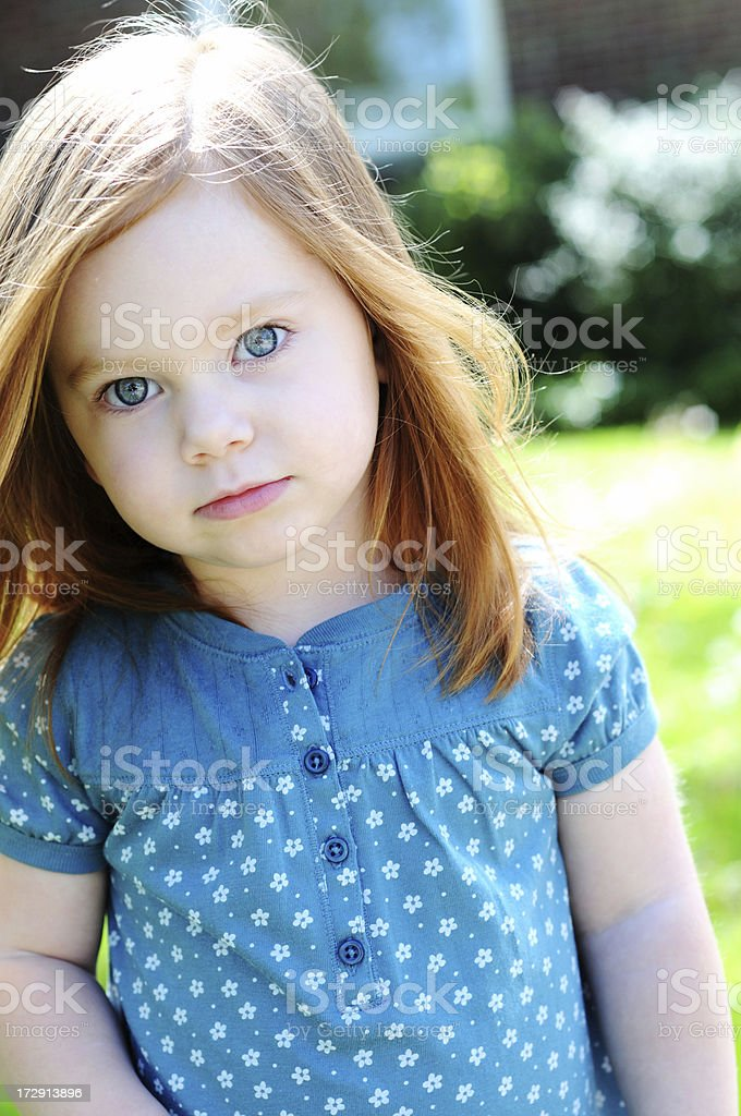 Little Girl with Blue Eyes Outside royalty-free stock photo