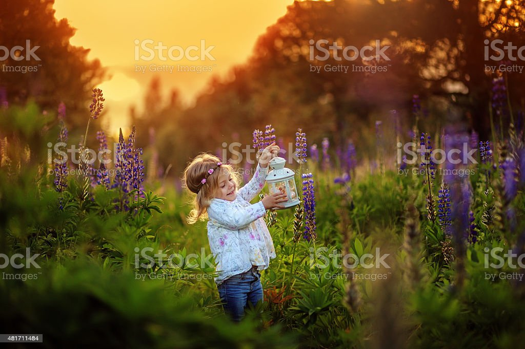 Little girl with blue flowers. royalty-free stock photo