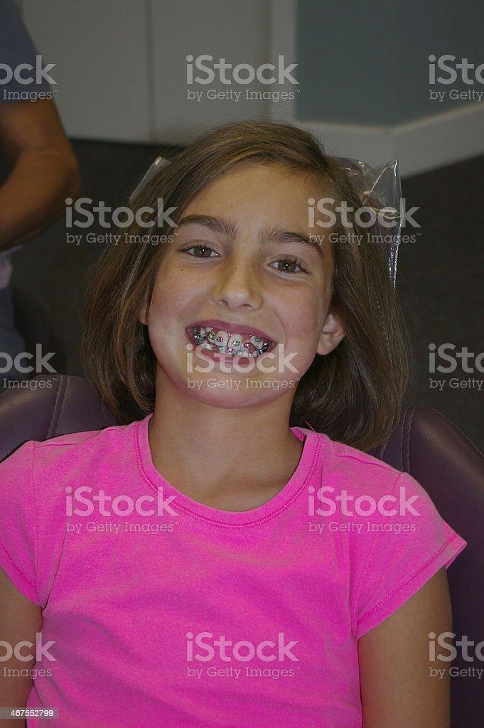 Little girl with brackets on teeth stock photo
