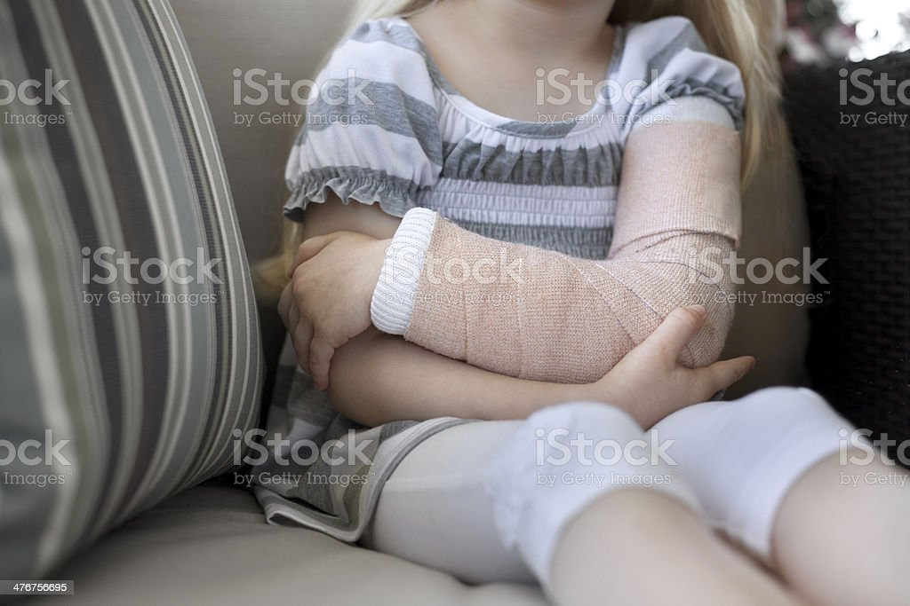 Little girl with broken arm stock photo