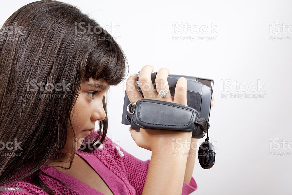 Little Girl With Brown Hair Filming Via Home Video Camera royalty-free stock photo