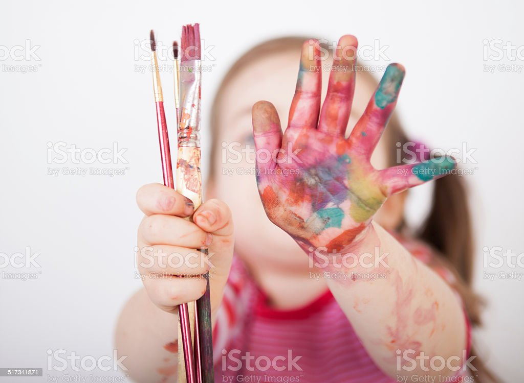 Little girl with brushes stock photo