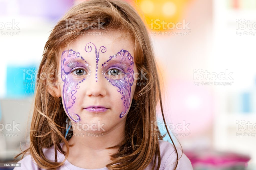 Little girl with butterfly face paint royalty-free stock photo
