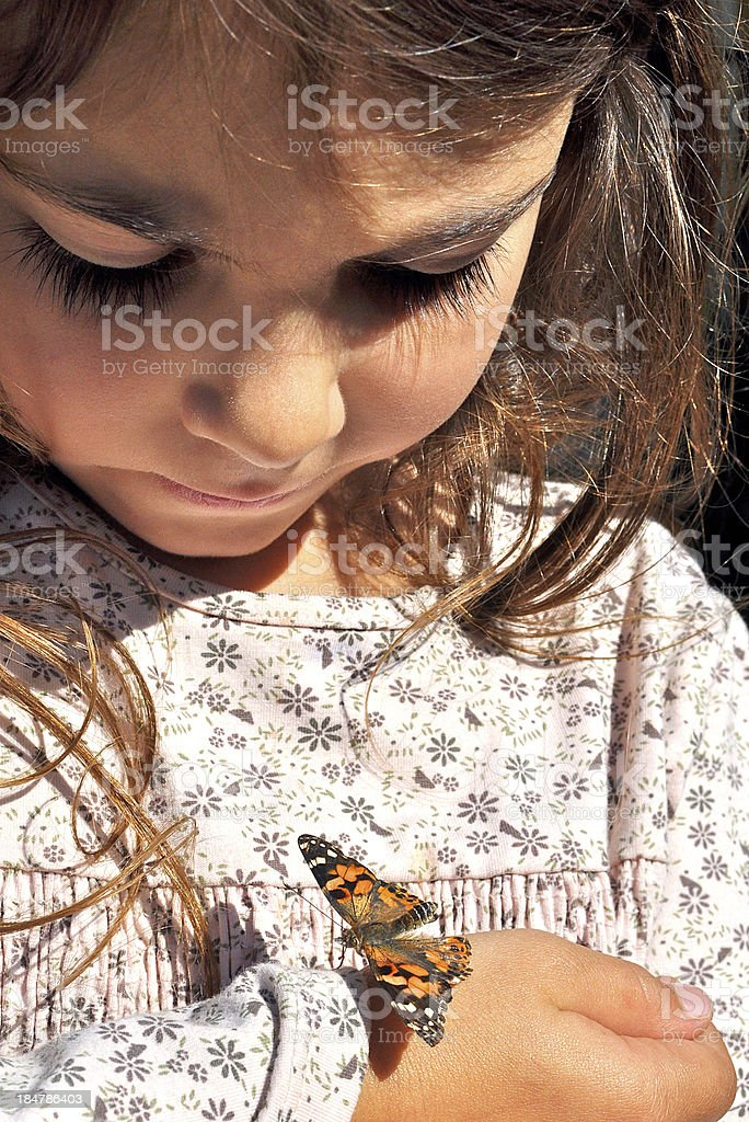 Little girl with butterfly royalty-free stock photo