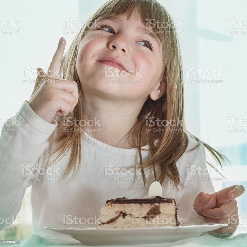 little girl with cake stock photo