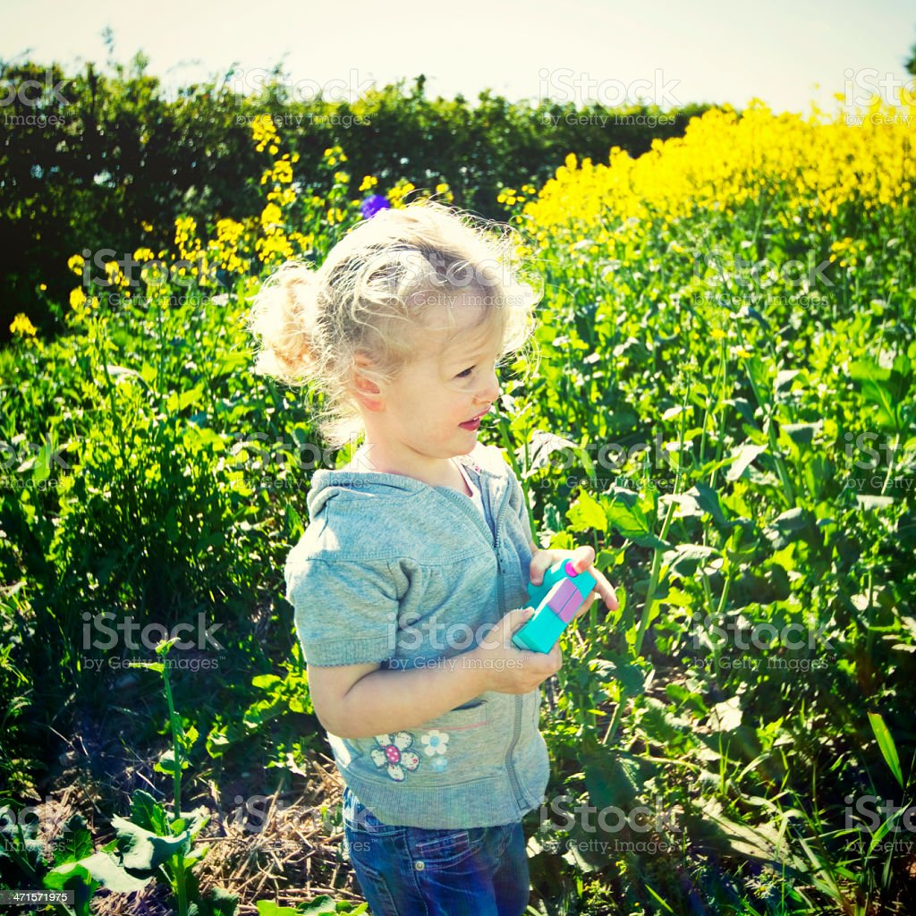 Little Girl with Camera in Field on Sunny Day royalty-free stock photo