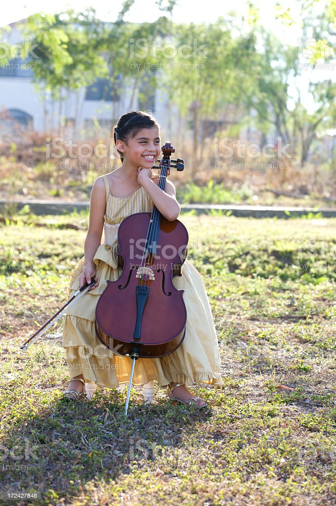 Little girl with cello outdoors royalty-free stock photo
