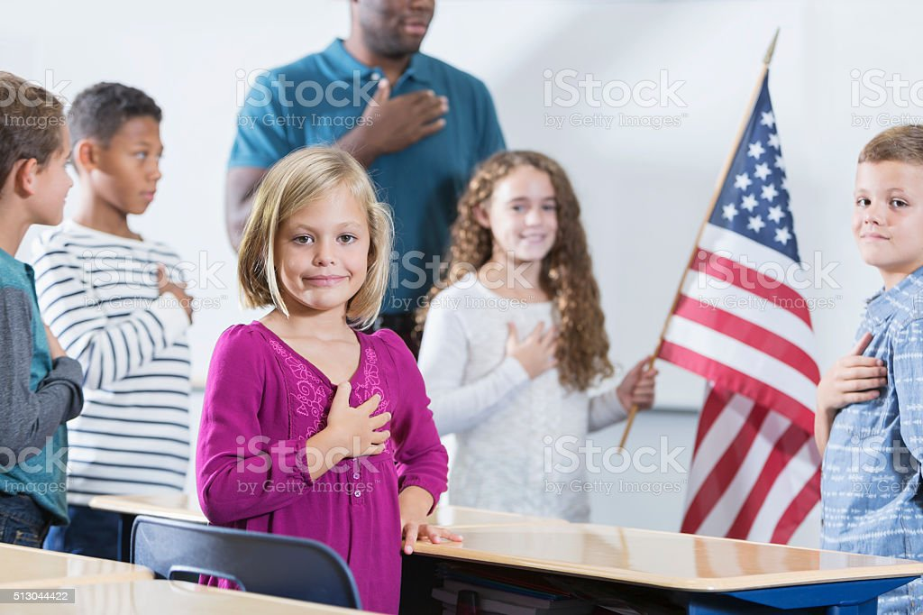 Little girl with class, American pledge of allegiance stock photo