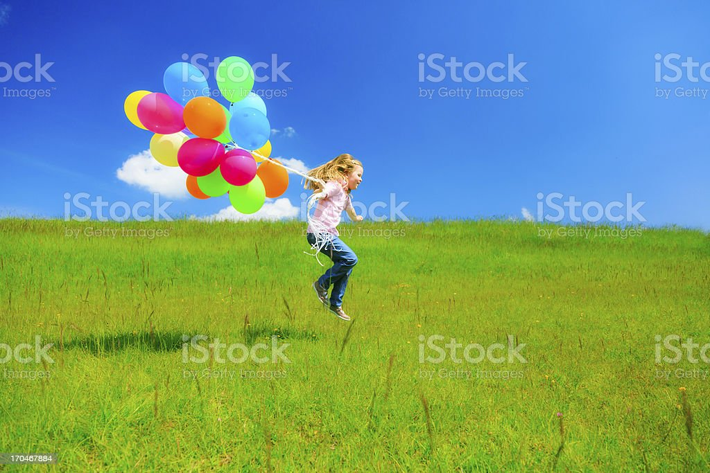 little girl with colorful balloons royalty-free stock photo
