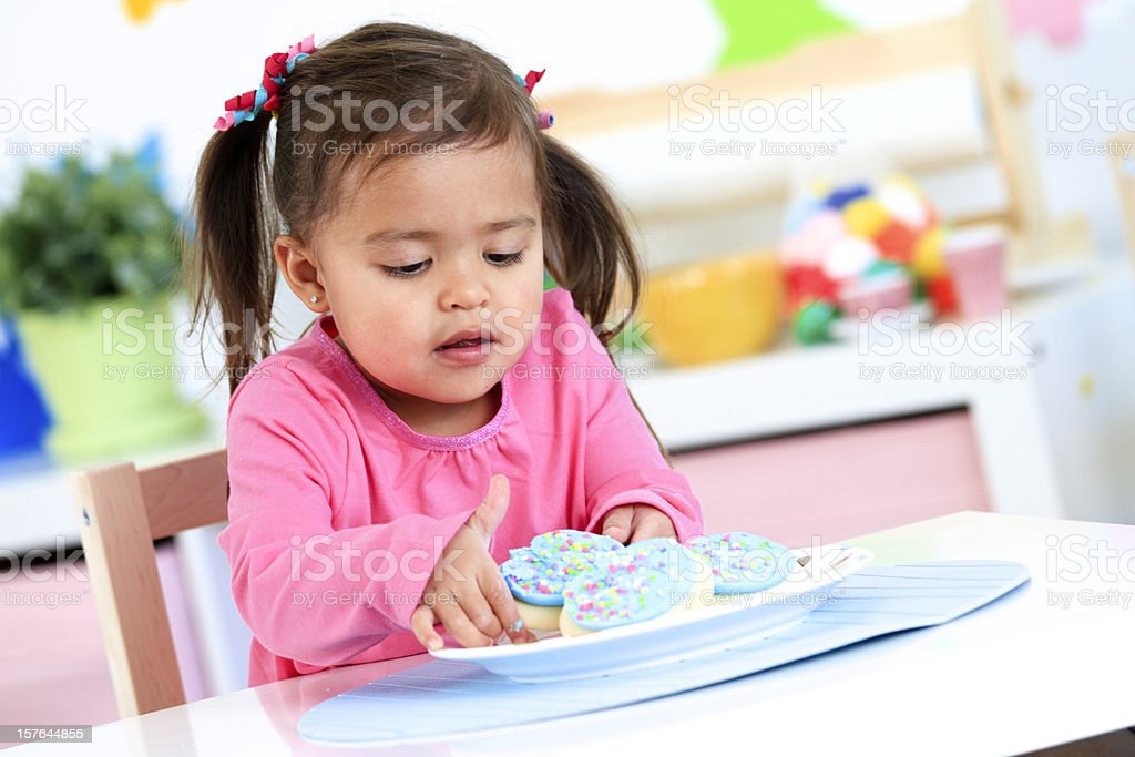Little Girl with Cookies royalty-free stock photo