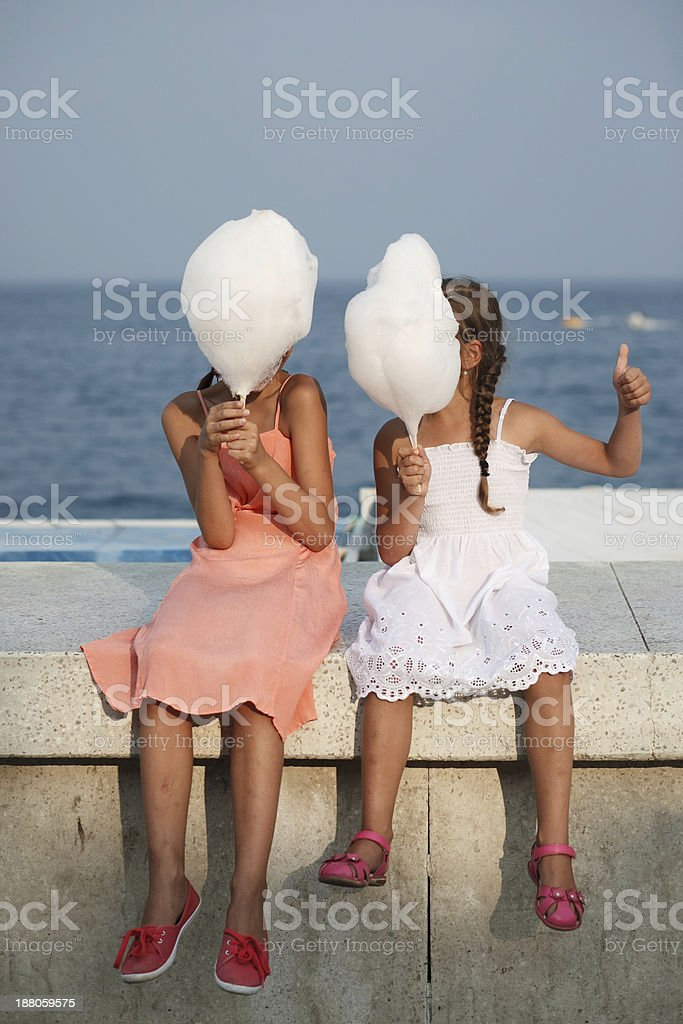 little girl with cotton candy royalty-free stock photo