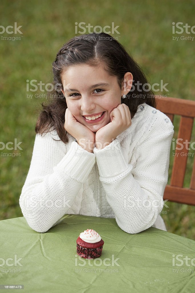 Little girl with cupcake stock photo