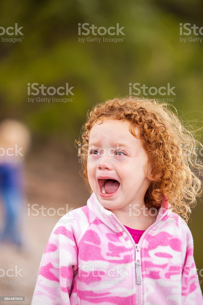 Little Girl With Curly Red Hair Crying stock photo