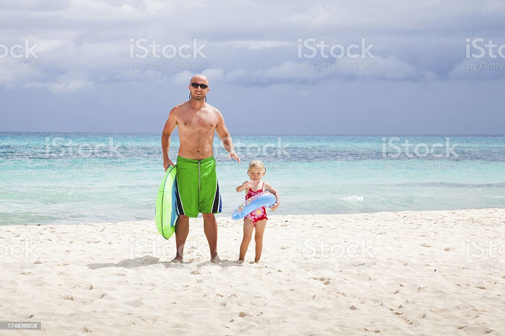 Little girl with dad at the beach in Mexico royalty-free stock photo