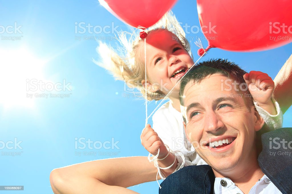 Little Girl with Dad Happy Balloon stock photo