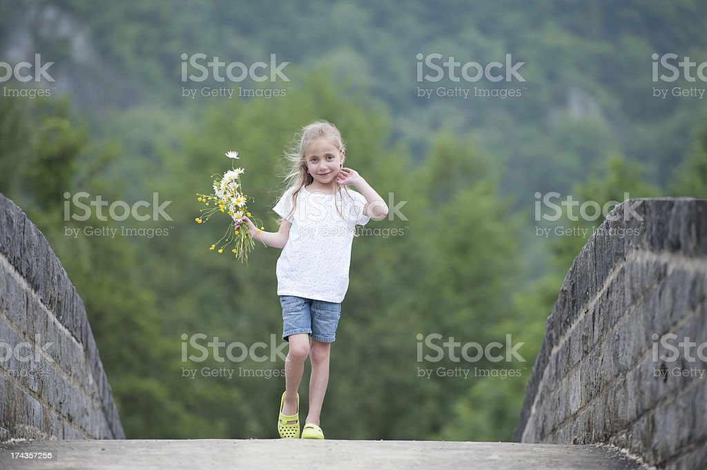 little girl with daisies in her hair royalty-free stock photo