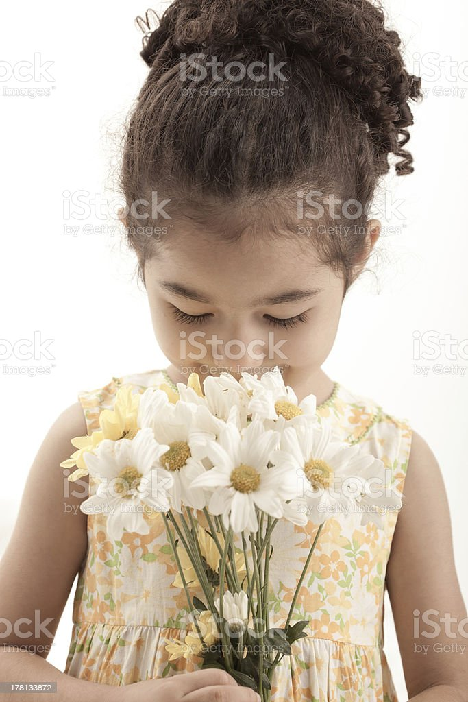 Little girl with daisy flowers royalty-free stock photo