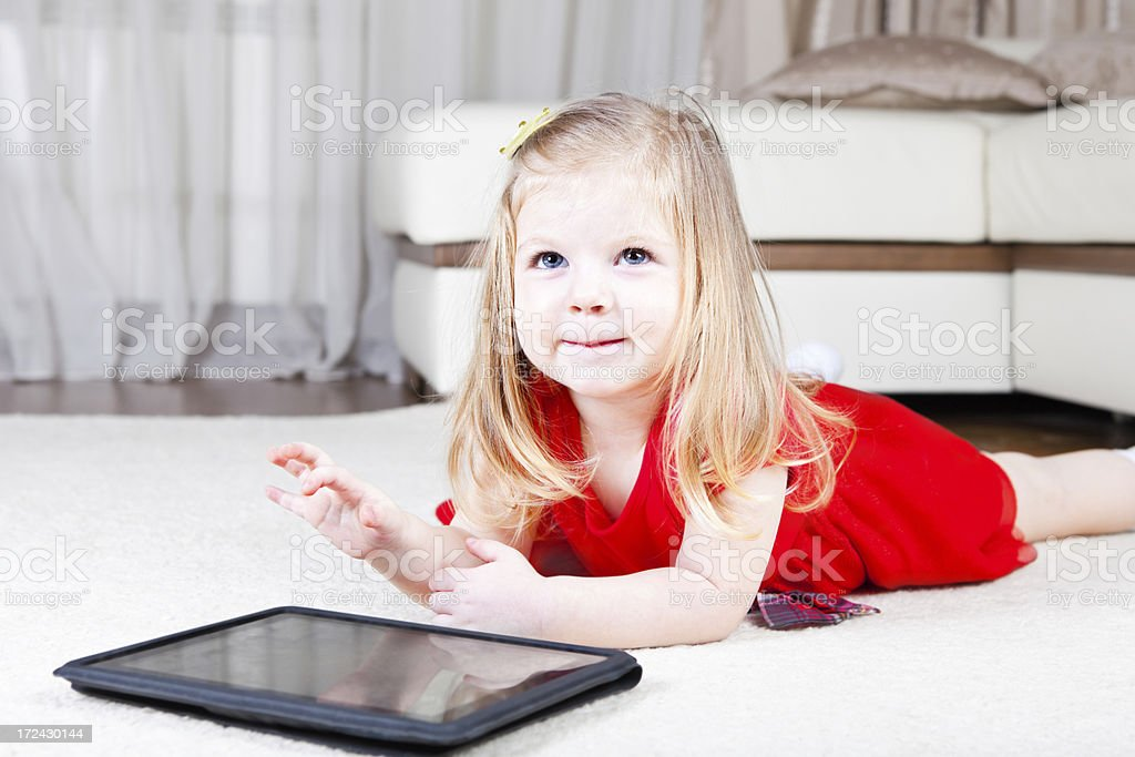 Little girl with digital tablet royalty-free stock photo