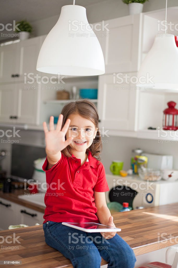 little girl with digital tablet stock photo