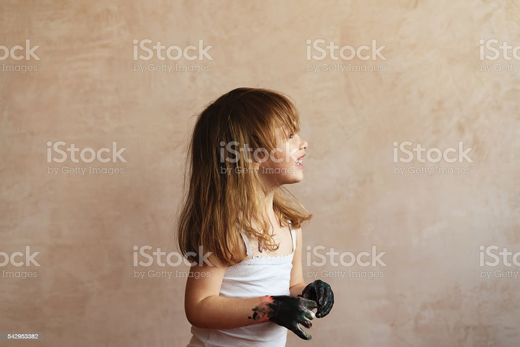 Little girl with dirty hands stock photo
